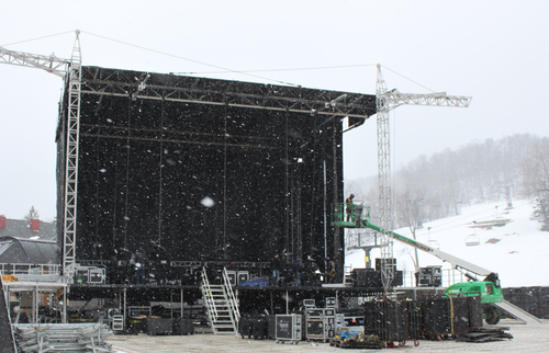 Stage hands worked through falling snow at Mount Snow Tuesday, setting up the main stage of the Minus Zero Festival. The electronic dance music celebration takes place Friday to Sunday.