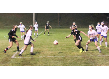 Twin Valley's Bianca Place, right, chases down the ball during the Wildcats' win over Poultney. At the far left is Sadie Boyd, who had three goals in the match, including the overtime winner with eight seconds remaining.